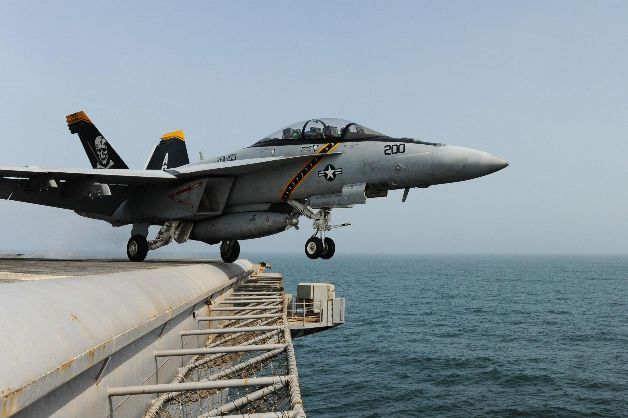 Guns and Military F/A-18F Super Hornet from the Jolly Rogers of Strike Fighter Squadron (VFA) 103
