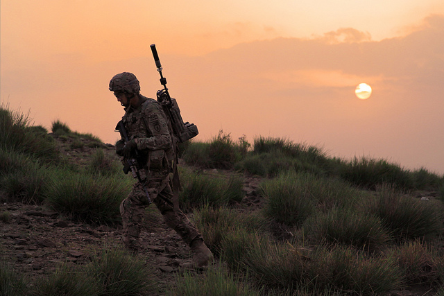 Guns and Military U.S. Army Pfc. Michael McKinney, a combat infantryman with the 1st Platoon, Delaware Company, Team Apache, 1st Battalion, 501st Infantry Regiment, Task Force 4-25, climbs a hill during a patrol to search for weapons caches outside Saparah, Khost province,
