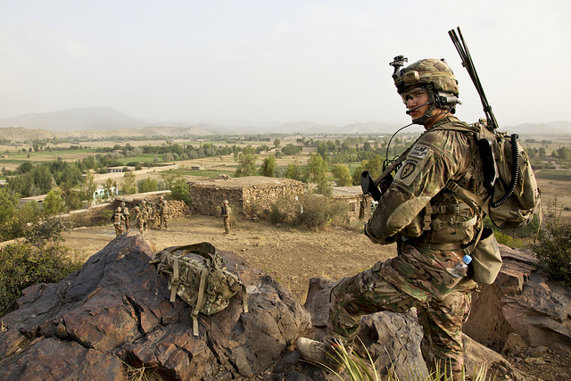 Guns and Military U.S. Army Spc. Jordan Duffy, a forward observer assigned to 1st Platoon, Apache Company, Team Apache, 1st Battalion (Airborne), 501st Infantry Regiment, Task Force 4-25, provides security from the top of a hill in Black Rock, Khowst province, Afghanistan,