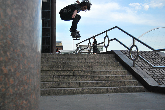 Skateboard Ollie down the local 8 stair.