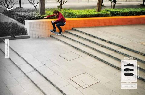 Skateboard  Alex Olson going beast with a hefty frontside 180 down a China double set