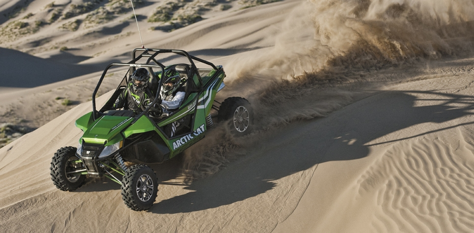 Auto and Cycle Tear it up with an Arctic Cat