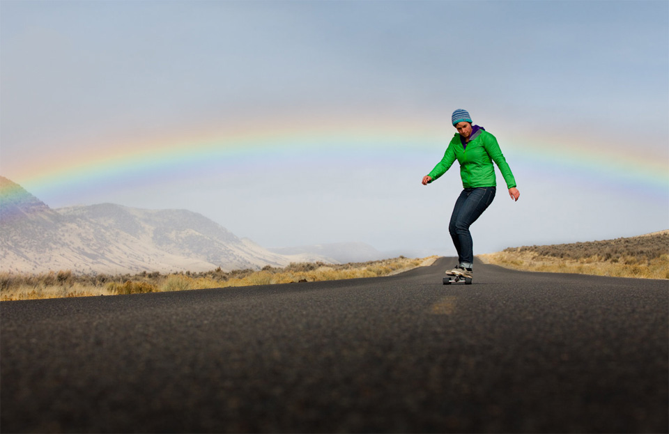 Skateboard longboarding below rainbow
