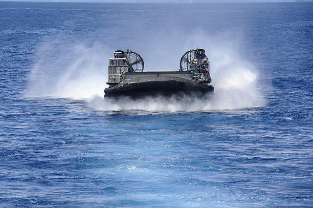 Guns and Military PHILIPPINE SEA (September 2,2012) -- A landing craft air cushion approaches the well deck of the forward-deployed amphibious assault ship USS Bonhomme Richard (LHD 6) to reload Marines and equipment for a certification exersize