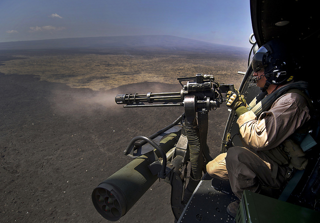 Guns and Military Cpl. Richard Sippl, UH-1Y Venom flight crew chief assigned to Marine Light Attack Helicopter Squadron 169 (HMLA-169), fires a 7.62mm GAU-17/A Minigun July 22, 2012, during a live fire combat training mission over the Pohakuloa Training Area,