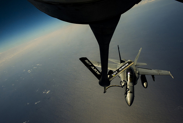 Guns and Military An Air Force KC-135 Stratotanker with the 465th Air Refueling Squadron refuels a U.S. Marine Corps F-18 Hornet over Hawaii in support of RIMPAC July 28, 2012. T