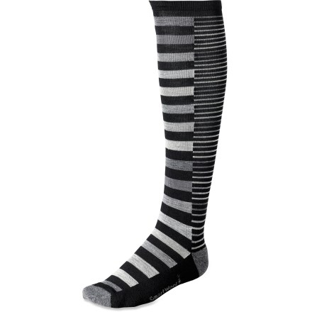 With 2 different sizes of stripes, the SmartWool Sassy Split Stripe socks are a fun diversion from the norm. Merino wool provides excellent temperature control and moisture management, so you're warm when it's cold and cool when it's warm. Merino wool keeps your feet dry and inhospitable to bacteria that can cause odor. WOW (wool on wool) technology increases wool content in high impact areas, improving durability and overall comfort. SmartFit system features an elastic arch and ankle brace, along with a contour flex zone to eliminate bunching, slipping and sagging. SmartWool Sassy Split Stripe socks are guaranteed not to itch and can be repeatedly washed and dried without shrinking. *Discount will be applied when you check out. Offer not valid for sale-price items ending in $._3 or $._9. - $16.93