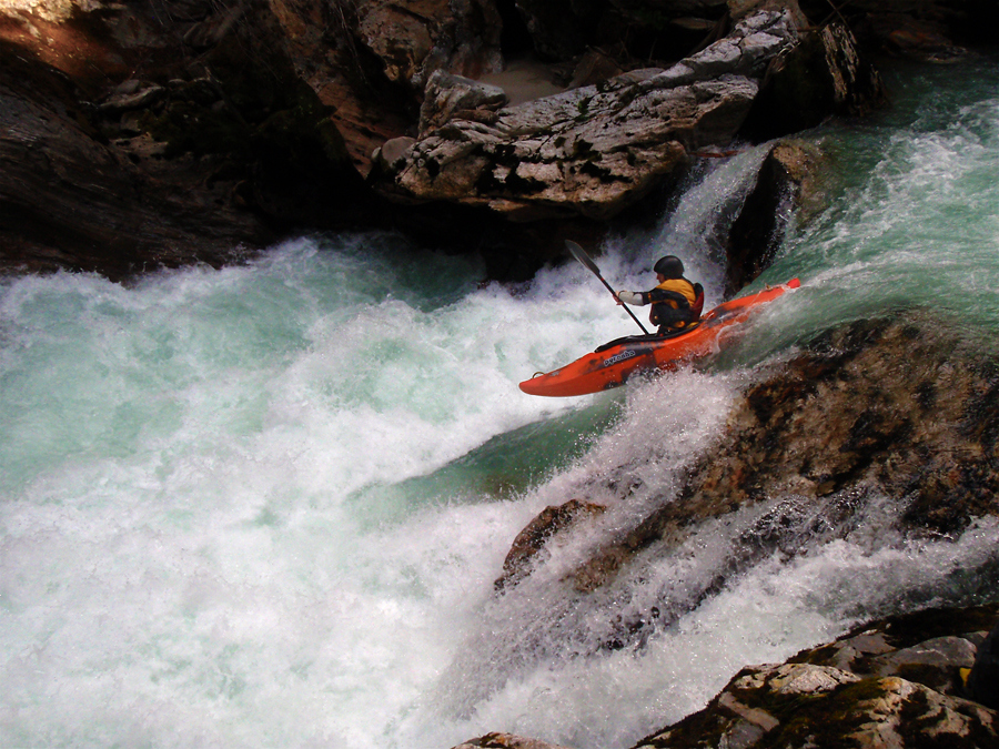 Kayak and Canoe A kayaker rides a tongue into the froth on Thunder Creek, a wilderness creek in the North Cascades of Washington State