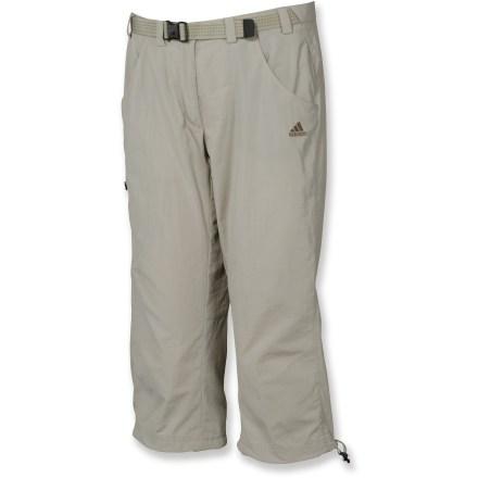 Camp and Hike Wear the women's adidas Hiking capri pants for treks into the woods or a stroll through the park. Quick-drying nylon pants are rugged enough to take on any challenge but are laundered for a cottonlike feel comfortable enough to wear all day. Waistband features an adjustable belt for a secure fit; zip fly with snap closure. Hand pockets let you stash a few everyday essentials; adidas Hiking capris also feature 1 thigh pocket with zip closure. Leg hems cinch down for active times. Closeout. - $41.73