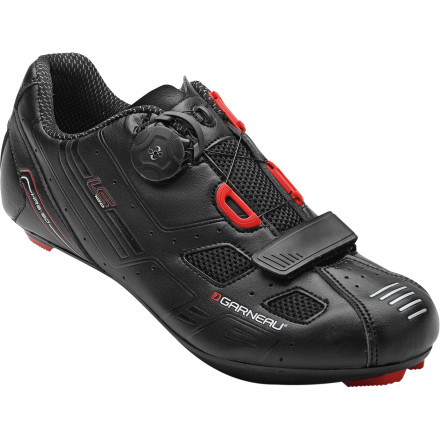 Fitness Who doesn't appreciate value' We certainly do, and if you're looking at the Louis Garneau LS-100 Shoes, you must as well. We simply can't think of any other shoes that better match technology features with price. In fact, with a BOA L4 retention system, a stiff outsole, and nearly unrivaled ventilation, we're still trying to figure out how Garneau essentially created a $350 pair of shoes for well under $300. Starting at the outsole, Garneau sought to achieve the perfect balance between strength, rigidity, and weight. Are you thinking carbon fiber' So were we. However, the LS-100 utilizes Garneau's Ergo Air II soles -- a carbon-reinforced nylon. This means that you gain both the stiff benefits of carbon fiber and the controlled flex of a nylon matrix. What does this really amount to, though' Well, coupled with the LS-100's low stack height, the Ergo Air II's composition and rigidity equate to a direct transfer of power to the pedals. Just like in frame design, the outsole has a stiffness-to-weight ratio that positively promotes an efficient carry of power with limited energy dispersion. So, in simpler terms, these outsoles make your hard efforts count in relation to speed. In terms of the aforementioned flexibility, you've surely felt berated by overly stiff outsoles at some point in your riding. The nylon matrix of the Ergo Air IIs amounts to a calculated percentage of 'give' under load. Essentially, this is minute enough that you won't notice it on climbs or hard drives, however, after 80k, your feet certainly will. Comfort without the penalty of weight is the design philosophy at work here. And speaking of weight, the LS-100 tips the scales at a lower weight than many other manufacturer's top offerings -- 255g per shoe. This is credited, in one part, to the outsole, but in our opinion, more so to the lightweight upper construction. - $135.95