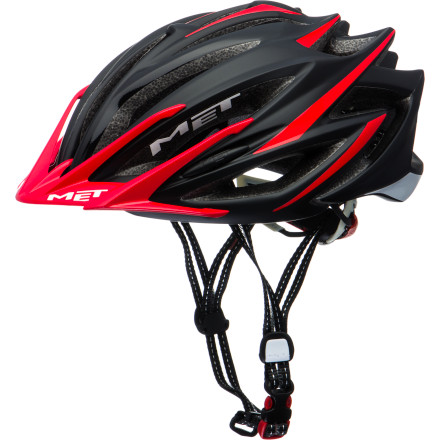 MTB Surely, you've been waiting with bated breath for MET's Veleno Helmet to land stateside, and we're happy to tell you that your wait is over. Now, for the first time, you gain access to one of the most technologically advanced, and comfortable, cross country helmets on the market. MET takes comfort seriously, however, it doesn't just aimlessly punch multiple ports into its designs to achieve this. Instead, MET developed a protocol called Air Scale to measure ventilation. Simply put, it measures two essential parameters -- the Head Contact Surface (HCS) and Cooling Factor (CF). The HSC indicates the percentage of the head that's in contact with the helmet. Why is this important' Well, common sense tells us that when HCS is high, there's simply no room for air to circulate. So, this lets MET design the HSC at a minimum, and in this case, the Veleno rests at 65%. Meanwhile, MET uses an advanced testing system called Fluid Flow Analysis (much like Computational Fluid Dynamics software) that measures the velocity and temperature of airflow as it passes through the helmet. This means that heat buildup is decreased as the design adapts to testing, accordingly giving its CF rating a 7.5 out of 10. Further adding to the Veleno's low CF are MET's Gel02 front interior pads and patented Coolmax anti-allergenic interior pads. And not only do these reduce pressure on the skull and skin, but they also encouraging rapid evaporation of perspiration for a cooling comfort. The pads aren't for impact protection, however, that's left to the Veleno's In-Mold Intelligent Fusion construction. What is this' Simply put, In-Mold means that the shell and outer are bound during the manufacturing process. Furthermore, the shock resistant shell is fused to the impact absorbing EPS foam inside. And taking a step even further, MET also reinforced the Veleno around its numerous vents in order to add structural integrity. - $104.95