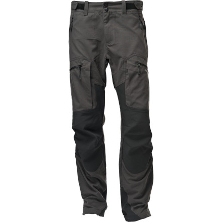 Camp and Hike The Norrna Svalbard Heavy Duty Hybrid Pant protects against water, wind, and cold, while giving you optimal mobility. The reinforced knee, seat and ankle panels mean you can play rough and tough for years. In fact, the pant may outlast the person. - $167.37