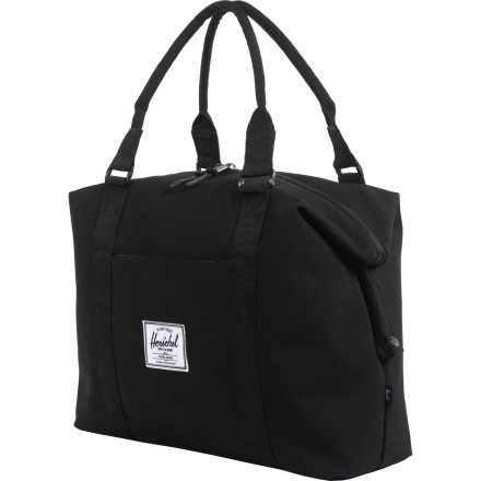 Entertainment The Herschel Strand Duffel Bag features a throwback design with comfortable padded handles, a large easy-access top pocket, and snap down sides for a slimmer profile when carrying lighter loads. - $59.95