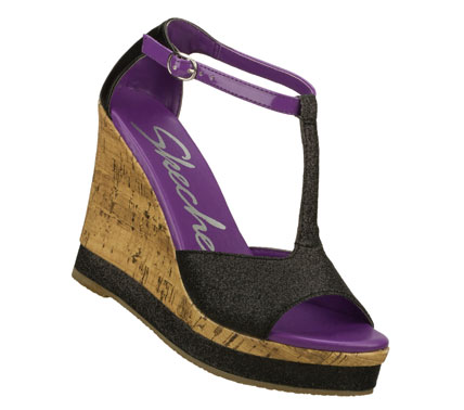 Entertainment Add some glittering glamour to any look with the SKECHERS Cali Bomb Shell - Let's Groove shoe.  Glitter finish fabric and smooth faux leather upper in a wedge heeled dress t-strap slide sandal with cork veneer wedge heel. - $50.00