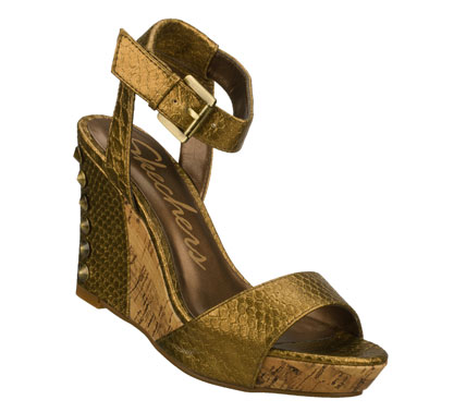 Entertainment Increase your visual value with the SKECHERS Cali Sky Scrape - Scrap Metal sandal.  Snake textured matte or metallic faux leather upper in a wedge heeled ankle strap dress casual slide sandal with stitching and metal stud detail. - $50.00