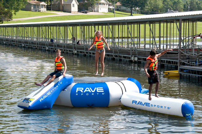 "RAVE Sports Splash Zone Plus includes a 12' diameter water bouncer, a 6' slide, a 10' long log and the EZ-Up boarding platform. This commercial grade reinforced water park is the best value and quality on the market! Bouncer: 12' x 36""; Slide: 7' x 35.5"" x 50""; Log: 10'4"" x 23""; EZ-Up: 40"" x 26"". Recommended for ages 6+.Key Features of the Rave Splash Zone Plus Water Park: Commercial grade reinforced construction Includes bouncer, slide, log and EZ-up boarding platform 4 anchor points Bouncer: 12' x 36"" Slide: 7' x 35.5"" x 50"" Log: 10'4"" x 23"" EZ-Up: 40"" x 26"" Recommended for ages 6+, 3 children (600 lbs. max weight) - $1,038.95"
