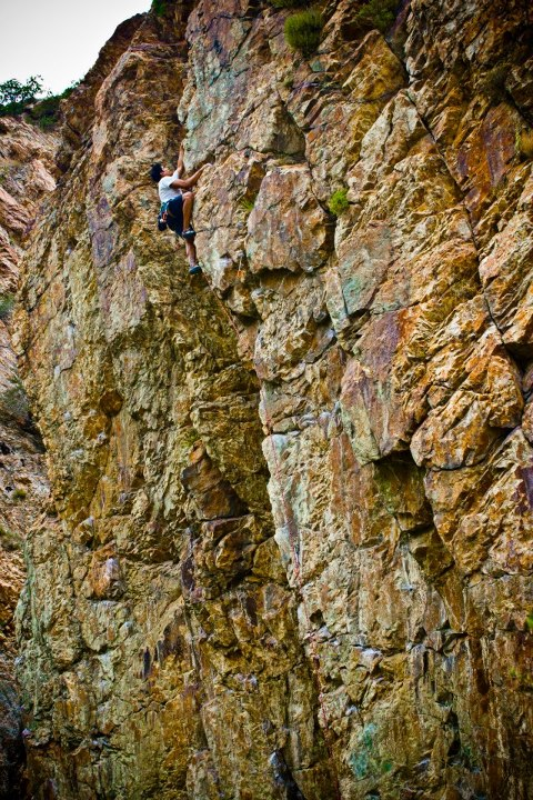 Climbing Mike Portanda, Liberty Mountain's Digital Assets Manager, climbs up Rebel Yell 5.11c on the Psychobabble Wall at the Storm Mountain Picnic Area in Big Cottonwood Canyon, UT.  Gear: Cypher Echo and Firefly II Quickdraws.  Photo by Benjamin L Eaton.