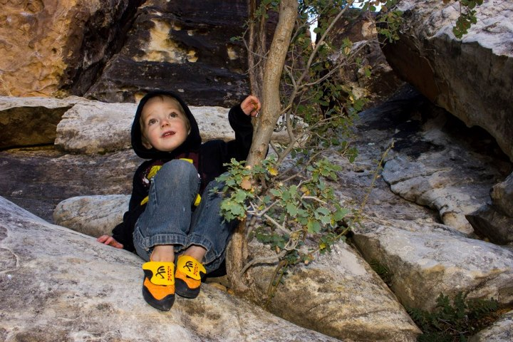 Climbing Fisher Eaton, age 4, enjoys the view after topping out with the new Cypher CodeBreakers in Red Rocks, NV.  Photo by Benjamin L Eaton