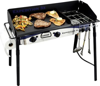 Camp and Hike Cook like a pro with a stove that boasts three 30,000-BTU commercial-grade cast burners. An all-steel range features sturdy grates built to support hefty cast-iron cookware and is surrounded by a three-sided steel windscreen to block drafts and grease splatter. The seasoned steel frying griddle fits over two burners and features restaurant-style sides and a convenient grease drain. The heavy-duty steel legs slide off for transportation and storage. Includes a paper-towel holder, utensil holder, adjustable heat-control dials, 3-ft. hose and regulator. One-year warranty. Cooking area: 38L x 16W. Cooking height: 30. Weight: 47 lbs. - $299.99
