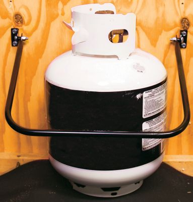 Entertainment Safely transport gas cans, utility jugs or propane bottles in your RV or pickup truck with the secure gas can holder from Extreme Max. Sturdy steel arm with baked-on, powder-coat finish prevents tipping and spilling. Folds up securely when not in use. Includes all mounting hardware. Dimensions: 16W x 13D. - $19.99