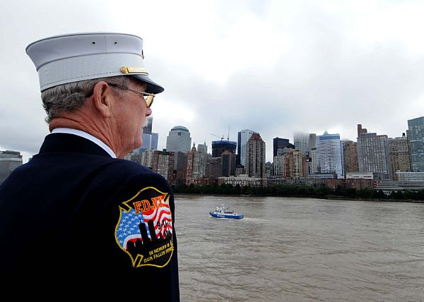 Guns and Military NEW YORK (Sept. 8, 2011) New York Fire Department Chief Jack Prichard prepares to present honors as they pass the World Trade Center and the National September 11 Memorial aboard the amphibious transport dock ship USS New York (LPD 21). New York has 7.5 t