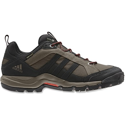 Camp and Hike The adidas Super Hiking Karak GTX hiking shoes boast a supportive platform with stout waterproof protection to ensure comfort as you churn through miles. Nylon mesh uppers feature nubuck leather overlays for support. Gore-Tex(R) liners make these hiking shoes waterproof yet breathable, for comfort in a variety of conditions. Quick-drying mesh linings help wick moisture away from feet to enhance in-boot comfort. EVA midsoles absorb shock, cushion feet and provide gentle support. Forefoot and midsole plates offer torsional rigidity and lightweight support; plates also guard against stone bruising. The adidas Super Hiking Karak GTX hiking shoes boast aggressive rubber outsoles for sure traction. Closeout. - $97.93