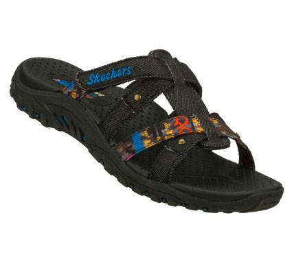 Surf Adventure more in style and comfort with the SKECHERS Reggae - Mohave sandal.  Soft denim fabric upper in a strappy comfort casual slide sandal with stitching accents and colorful print detail. - $55.00