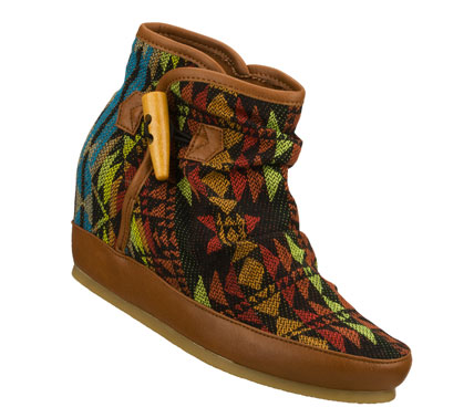 Easy wearing style rules in the SKECHERS SKCH Plus 3: Soaring Eagle - Aztec Empire boot.  Soft woven solid or patterned fabric upper in a slip on casual hidden wedge ankle boot with slouched design and smooth synthetic trim. - $75.00