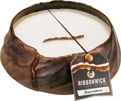 A black-bronzed finish imbues the RibbonWick Brownstone Candle with a sophisticated elegance and natural charm. It has an aromatic amber scent with notes of citrus and bronzed musk. A flowing wick design creates a hypnotic flame that dances across a pool of highly scented wax.Available:Round 65-hour burn time and measures 3H x 8 diameter.Rectangle 30-hour burn time and measures 9.3L x 3.8W x 2.5H.Oval 60-hour burn time and measures 7.5L x 4W x 3.8H. - $29.88