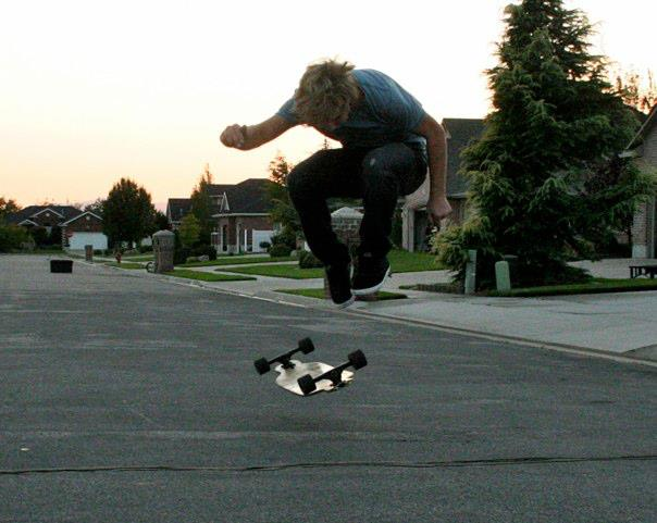 Skateboard Kick flip. ON A LONGBOARD!