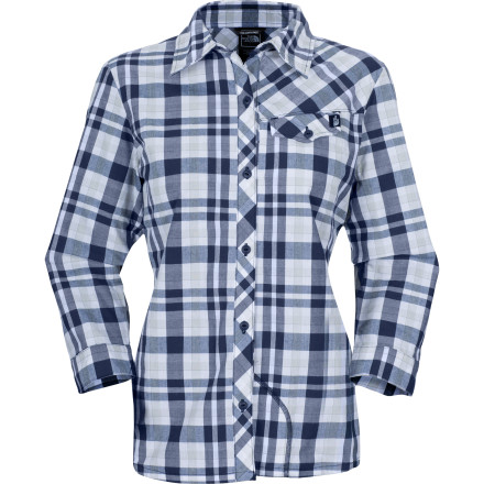 Camp and Hike The North Face Women's Brushcut Long-Sleeve Shirt has the look of a cool plaid shirt, but performance features like UPF and all-over reflectivity mean you can wear this shirt on your bike commute home or an afternoon hike without having to change into a different shirt. - $74.95