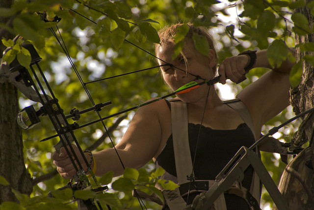 Hunting Kerrie practices bow hunting from 20 feet up in a tree stand