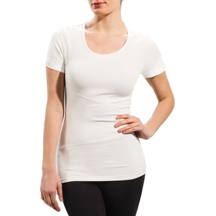 The Lole Curl top transitions easily from work to workout with its feminine look and performance fabric. Feel-good, quick-dry blend of nylon and elastane is soft and comfortable whether the shirt is being worn under a suit jacket at the office or by itself during Zumba class. Fabric protects skin from too much UV light with a UPF rating of 50+. Small envelope pocket on the back holds your digital music player. Closeout. - $20.73