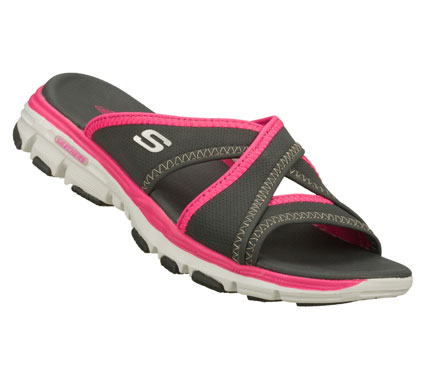 Surf Brighten up your warm weather look with the fun sporty style of the SKECHERS Bravos - Outshine sandal.  Soft faux leather upper in a cross strap slide sandal with sporty detailing and flexible sneaker-style comfort sole. - $38.00