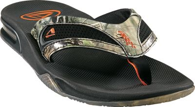 Surf Reef Realtree Flip-Flops sport synthetic nubuck uppers for wear at the beach and even in the water. Realtree camo uppers. Compression-molded EVA footbeds with anatomical arch support. Full 360 heel airbags are enclosed in soft polyurethane. Integrated church key for opening your bottled beverage of choice. Grippy-rubber outsoles suitable for various terrain. Imported.Mens whole sizes: 8-14 medium width.Color: Realtree. - $49.88