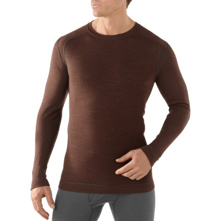 Upgrade your long underwear drawer with the men's SmartWool Midweight Crew top. With warmth, natural stretch and breathability, this top offers lightweight, durable insulation in cold weather. Merino wool helps maintain a comfortable internal temperature whether the climate is warm, cold or in-between. With a UPF 50+ rating, fabric provides excellent protection against harmful ultraviolet rays. Shoulder panels eliminate top shoulder seams, reduce chafing and optimize comfort under pack straps. Rear body seams wrap around to front to enhance fit, and sculpted side panels also enhance fit. Flatlock stitching eliminates abrasion, increases comfort and enhances fit by reducing bulky seams. The men's SmartWool Midweight Crew top does not itch and will not shrink; machine wash and dry. Closeout. - $59.73