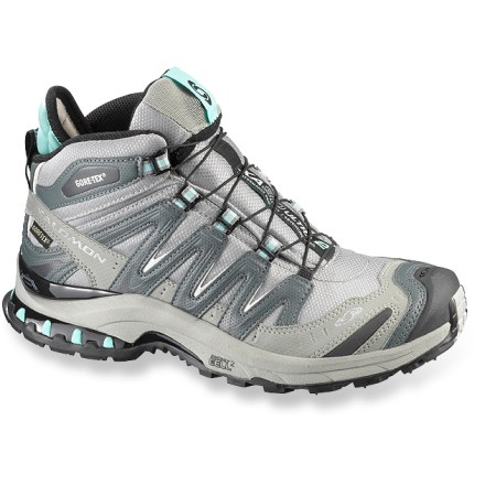 Fitness Salomon XA Pro 3D Mid 2 GTX hiking shoes for women blur the lines between trail-running and light hiking, providing exceptional protection and support. Breathable and lightweight polyester mesh uppers feature thermoplastic urethane overlays to secure insteps and lock heels down; protective toe and heel caps provide protection. Kevlar(R) Quicklace(TM) lacing system takes just 1 pull for a precise fit; lace pocket hides lacing away so it won't catch on anything. Gore-Tex(R) XCR(R) seam-sealed inner booties offer a high level of breathability while retaining complete waterproof protection. Polyester linings wick moisture away from feet; contoured Ortholite(R) foam footbeds enhance comfort underfoot. Dual-density EVA midsoles deliver enhanced durability and cushioning for all-day comfort. Thermoplastic urethane midsole inserts supply protection and stability. Nonmarking Contagrip(R) rubber outsoles on the Salomon XA Pro 3D Mid 2 GTX hiking shoes deliver optimal performance on mixed terrain. Closeout. - $66.73