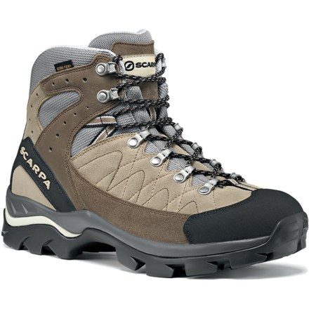Camp and Hike With Gore-Tex liners and suede leather uppers, the rugged Scarpa Kailash Gore-Tex(R) boots can handle day trips, trail hiking or light winter walking with ease. Suede leather uppers provide superb durability, support, and water resistance. Gore-Tex(R) waterproof membranes let feet breathe while protecting them from the elements, keeping them dry and comfortable. Moisture-wicking synthetic sock liner absorbs and disperses sweat to keep feet and boots comfortable. Close-to-toe lacing provides a snug, climbing-shoe fit and gusseted tongues repel trail debris; rubber rands protect toes against bumps and abrasion. Polyurethane and EVA midsoles provide ample cushioning for all-day use. Comfort-Flex polyethylene and fiberglass midsole support plates stabilize feet by controlling torsional and forefoot flex. Lightweight Vibram(R) Hi-Trail outsoles ensure superb trail traction. Closeout. - $81.73