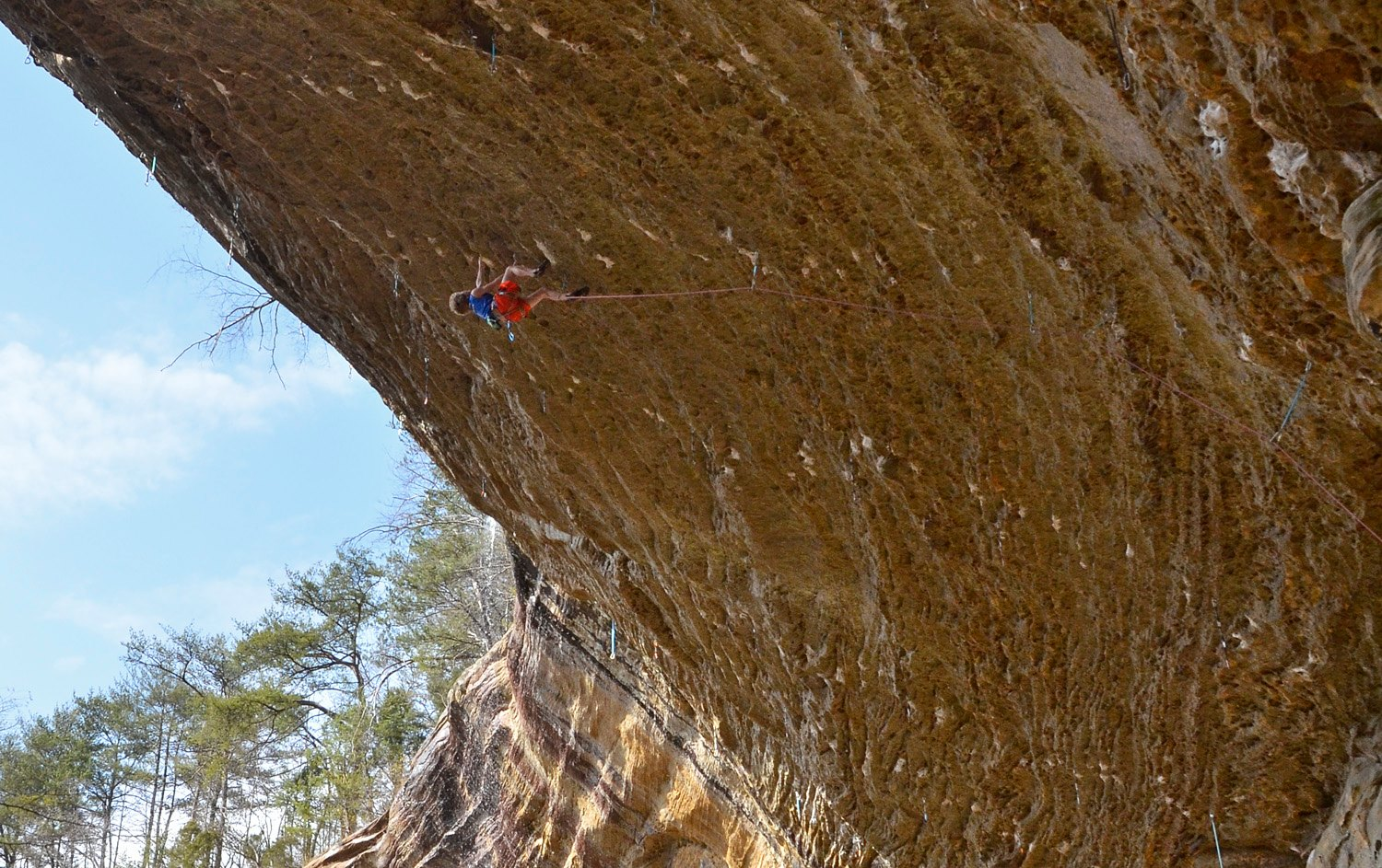 Climbing Cameron Horst climbing The Madness (13c) on of the longest, steepest sport climbs in America. Red River Gorge, KY.
