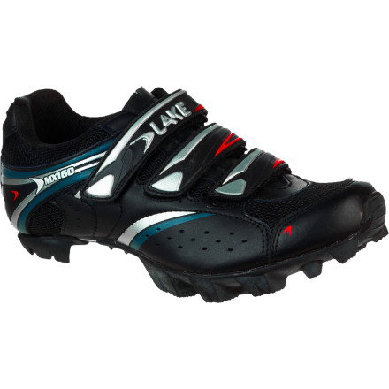 MTB The Lake Women's MX160 Mountain Bike Shoe combines durability, style, and comfort. This simple, straightforward shoe doesn't require a Master's Degree or a lab to set up comfortably, and you won't have sell your car to afford it. Lake constructed the uppers of its Women's MX160 shoes with its Action Leather. This material combines split leather with a polyurethane surface treatment. With this blend, you receive the comfort and breathability that you expect from leather shoes, along with the added benefit of a long-lasting, treated surface. The polyurethane surface coating increases water-resistance and durability, while also reducing shoe stretch. Mesh panels surround the opening and tongue, further enhancing moisture transfer and breathability. This means that your feet stay cool and ventilated, even on hot days. Three standard hook-and-loop straps control volume and retention. Together, the three straps evenly distribute pressure and securely hold your foot in place. Lake's fiberglass-injected high-impact nylon sole provides you with a stiff, durable pedaling platform, and the real rubber outsole delivers grippy, non-marking traction. Perforated removable insoles let you swap in your favorites if you'd like, and reflective Lake logos increase your visibility to motorists in low-light riding conditions. Lake designed the MX160 with its Competition Last. It puts the foot in a position that allows energy to be focused on the pedal spindle to direct your energy efficiently, directly to the pedal. The competition Last also offers a bit more room in the forefoot than most race shoes. This makes the MX160 comfortable during long-distance rides of four hours or longer. Lake Women's MX160 Shoes are available in the color Black/silver in whole sizes from 36.0 to 43.0. - $59.99