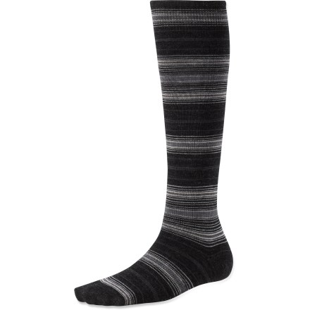 The SmartWool Arabica Stripe knee-high women's socks keep your feet cool and comfortable with a soft blend of moisture-wicking merino wool. Made from soft merino wool blended with nylon, these socks wick moisture away from your feet, keeping them dry and cool in summer and warm in winter. SmartFit system features an elastic arch and ankle brace, along with a contour flex zone to eliminate bunching, slipping and sagging. SmartWool socks are guaranteed not to itch and can be repeatedly washed and dried without shrinking. Closeout. - $13.73