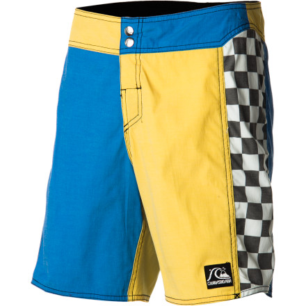 Surf The Quiksilver Kwock Rock Board Short offers streamlined retro style, thanks to a color-blocked checkerboard pattern, abbreviated 18-inch inseam, and button-closure waist. - $47.60