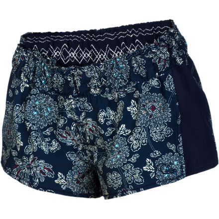 Surf The short and sweet Quiksilver Women's Barrier Reversible Board Short gives you two pretty pattern options to suit your fancy. And the polyester-spandex construction with a smocked waist allows easy on-off and provides movable comfort. In the water or on the sand, this cute short is fun and functional. - $44.63
