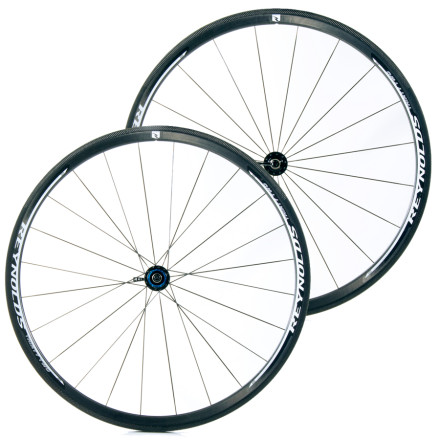 "Fitness Clincher is a word you rarely see paired with ""climbing wheels."" However, the two go together perfectly with the Reynolds Thirty Two Carbon Clincher Wheelset. Unlike many other climbing clinchers, these hoops have low spoke counts, 20 in the front and 24 in the back. Fewer spokes here means aerodynamic efficiency as well.The name refers to the rim depth. While 32mm is relatively shallow these days, it's deep enough to make an aero difference. Add to that the details that Reynolds addresses, and you'll maximize the effect. The spoke nipples are hidden from the wind, inside the rim, and they also have Reynolds' patented Swirl Lip Generator to make the wheel even faster.The Swirl Lip Generators are two tiny lips on either side of the narrow edge of the rim. If you didn't know better, you might think they were parting lines that weren't sanded down after the rim came out of the mold. There's no sanding forgotten, and they're hardly an accident. The SLG creates turbulence that helps the airflow reattach faster behind, after passing over the rim. They also have the effect of decreasing sideways air force on the rim, and in so doing, make your bike easier to steer in crosswinds. This means it takes less concentration and less strength to pilot the bike, which means you can devote more concentration and more strength to going fast.The second big change is their new CTg brake track. C is for Cryo, Tg for glass transition temperature. As you know, heat build-up is not a good thing at the brake track. For clinchers, heat build-up can lead to deformation of the rim at the brake track, which can lead to a tire literally blowing off the rim. Another worry is brake pads melting in the ...perfect for the hardest courses, where the terrain demands a light wheelset, yet they give little away on flat, windy roads... heat. The new CTg tracks are the result of a new resin system and a new laminate structure. - $1,855.00"