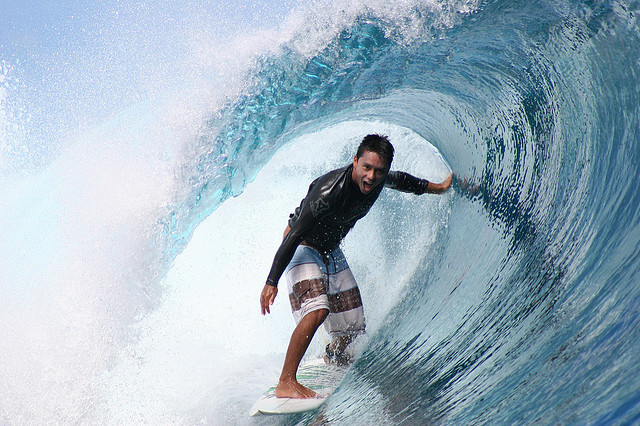 Surf Dennis Tihara is having the best time surfing at Teahupoo, Tahiti.