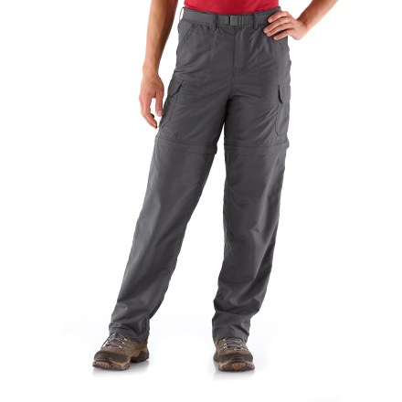 Fitness The REI Sahara Convertible petite-size pants with No-Sit Zips feature an innovative design that makes converting from pants to shorts and back again easier than ever before! Side zippers run the full length of the lower legs; together with thigh zippers they allow quick conversions without having to sit down. They also preclude the need to slip lower legs sections over messy boots when converting from pants to shorts along a muddy trail. Color-coded thigh zippers help you easily tell the right leg from the left leg when converting back to pants. Lightweight nylon faille fabric dries quickly, resists pilling and is easy to pack away in a backpack. Fabric is treated with a Durable Water Repellent finish to repel moisture and stains. With a UPF 50+ rating, fabric provides excellent protection against harmful ultraviolet rays. Flat front waist flatters and smooths the figure; includes snap closure, belt loops and a removable webbing belt. Mesh pockets bags enhance ventilation and allow water to drain. Gusseted crotch facilitates freedom of movement for increased comfort. Topstitching throughout flattens seams and reduces abrasion. Front angle-entry pockets; right side has a hidden zip pocket inside. Zippered back pockets; pleated patch flap cargo pockets with bellows provide roomy storage space. Articulated knees provides a comfortable fit. Sahara petite pants feature a relaxed, easy fit. - $29.83