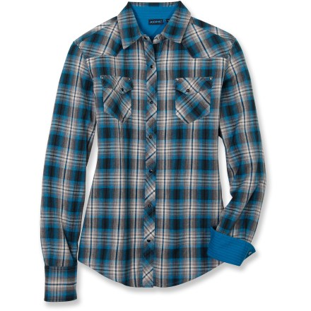 From the trails of your favorite national park to the sidewalks of your neighborhood, the Kuhl Sheridan flannel shirt in zenith blue looks great on its own or layered over your favorite T-shirt. Cotton/synthetic fabric blend offers soft, breathable comfort. Sheridan shirt features 2 riveted chest pockets and pearl snap closures on placket. Closeout. - $34.73