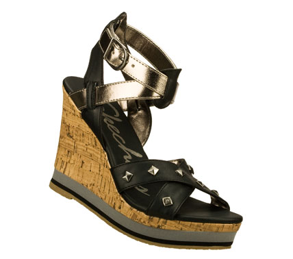 Entertainment Frame your feet perfectly in the SKECHERS Bomb Shell - Pop Art sandal.  Smooth faux leather upper in a dress casual wedge heeled strappy slide sandal with stitching and metal stud detail. - $50.00