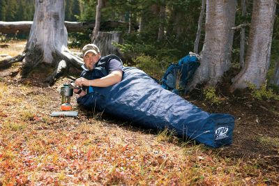"Camp and Hike When space and weight are at an absolute premium, leave your tent at home and pack our XPG Bivy Sack (weighs less than 2 lbs.). The 100% waterproof, breathable Dry Plus shell blocks moisture without becoming stuffy. Breathable internal mesh panel for added comfort. Water-resistant YKK zipper. Adjustable drawstring hood. Keep in your pack or vehicle for emergency use. Imported.Available: Regular 34"" x 84"". Carry weight: 1 lb. 6 oz. Large 40"" x 90"". Carry weight: 1 lb. 9 oz. - $89.99"