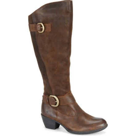Rich leather uppers and oversized buckles make the Born Kylli boots a stylish choice for casual days. Full-grain leather uppers with leather and fabric linings boast tall 14.5 in. shafts; handsewn Opanka construction supplies flexibility and comfort. Shaft circumference is 17.5 in. Interior zippers make them easy to pull on and off; ankle and calf straps offer small adjustments for a comfortable fit. Combined rubber midsoles/outsoles feature steel shanks for lightweight support. The Born Kylli boots feature 2 in. heels. Closeout. - $81.73